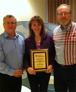 Stephen Kennedy, project manager and Robert Porter, project manager at the Wood Manufacturing Council present Violet Frost with her award.